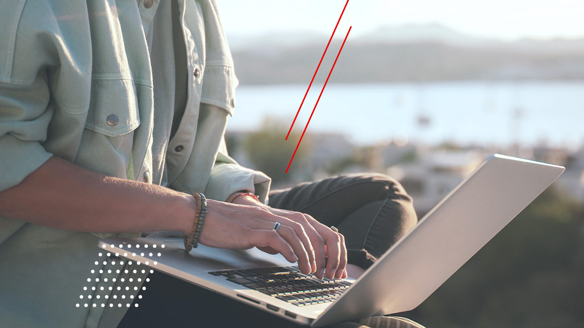 Man using a computer at an outdoor location