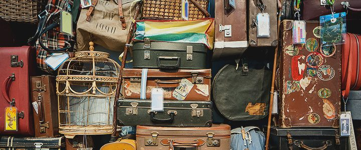 Large collection of varying types of luggage to represent the diverse world of travel managed and organized by Travel Agencies
